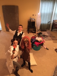 Braeden's middle school project that turned into a full cast including two best friends, and four siblings! This photo shows Braeden, Logan, and Abby (as an Ewok) in full costume ready to start filming :)