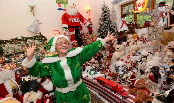 woman-with-santa-s-grotto-house-543619